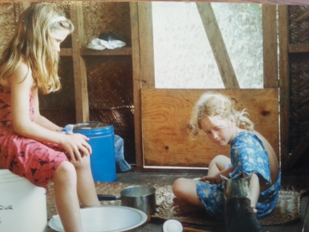 My sister and I on the veranda grating coconut (and feeding the cat).