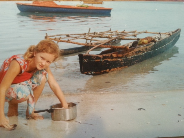 Me washing a pot on the beach.